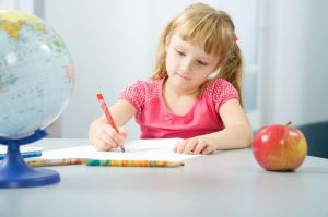 Girl writing with colored pencil
